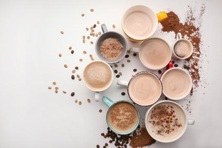 Foto de Many cups with tasty aromatic coffee on white background - Imagen libre de derechos