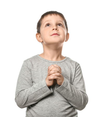 Photo for Little boy praying on white background - Royalty Free Image