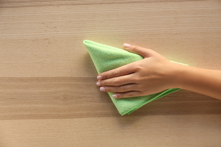 Photo for Woman cleaning wooden surface, top view - Royalty Free Image