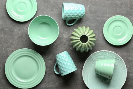 Foto de Tableware and decorative vase on grey background - Imagen libre de derechos