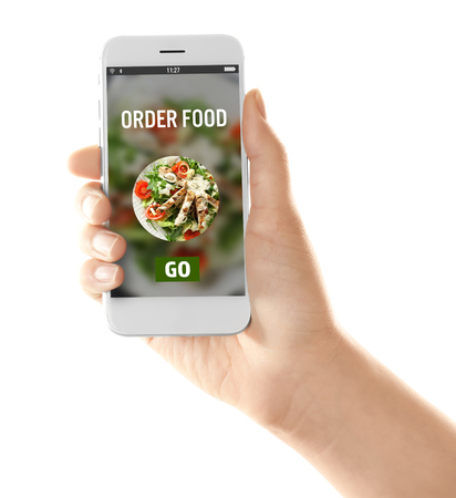 Photo pour Woman holding mobile phone with open page of food delivery service on white background - image libre de droit