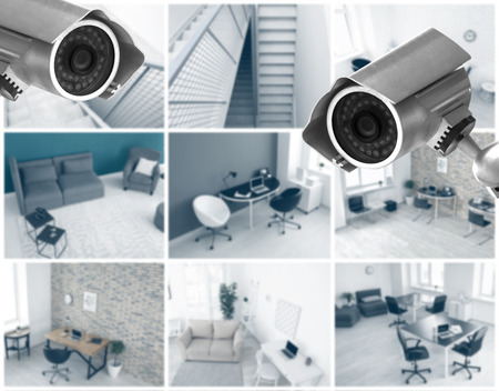 Foto de Modern CCTV cameras with blurred view of office locations - Imagen libre de derechos