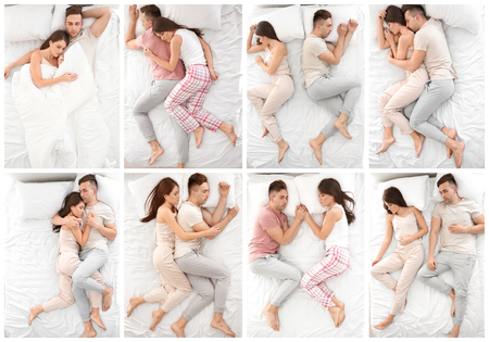 Foto de Young couple sleeping in different positions on bed, top view - Imagen libre de derechos