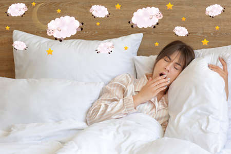 Photo pour Young woman suffering from sleep deprivation in bedroom - image libre de droit