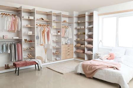 Photo pour Interior of white modern bedroom with wardrobe - image libre de droit
