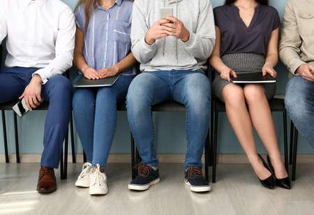 Photo pour Young people waiting for job interview indoors - image libre de droit