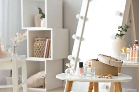 Photo for Table with accessories and cosmetics in modern makeup room - Royalty Free Image