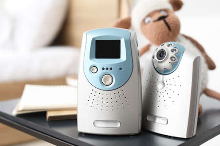 Photo pour Video baby monitor on table in room - image libre de droit