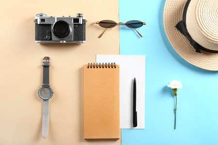 Photo for Photo camera, sunglasses, notebook, watch and hat on color background - Royalty Free Image