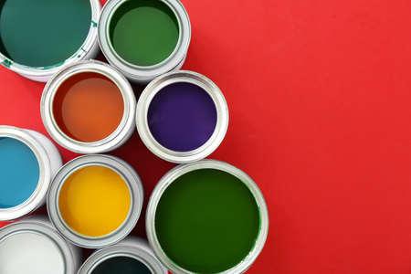 Photo pour Cans of paints on color background - image libre de droit