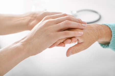 Photo for Doctor supporting elderly woman in clinic, closeup - Royalty Free Image