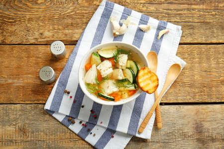 Foto für Bowl of tasty soup on wooden table - Lizenzfreies Bild