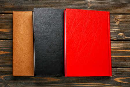 Photo pour Different books on wooden background - image libre de droit