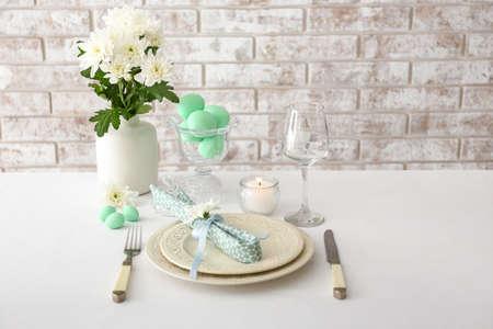 Photo pour Table set for Easter celebration - image libre de droit