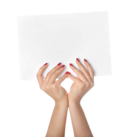 Photo for Female hands with empty sheet of paper on white background - Royalty Free Image