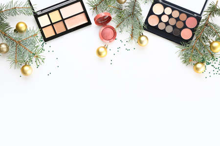 Photo pour Christmas composition with decorative cosmetics on white background - image libre de droit