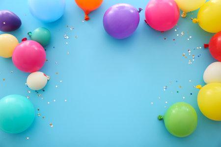Foto de Many balloons on color background - Imagen libre de derechos