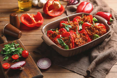 Photo for Baking dish with tasty stuffed pepper on table - Royalty Free Image