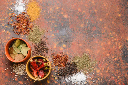 Photo for Bowls with different spices on color background - Royalty Free Image
