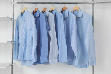 Photo pour Rack with clothes in modern dry-cleaner's - image libre de droit