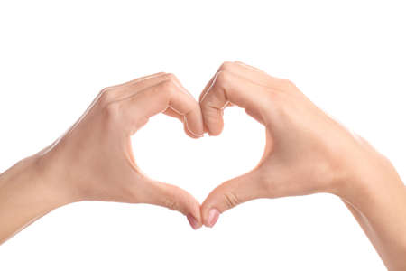 Photo pour Young woman making heart with her hands against white background - image libre de droit