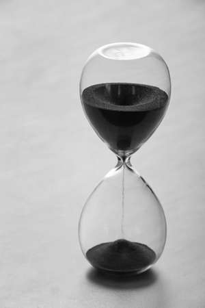 Photo pour Crystal hourglass on light background - image libre de droit