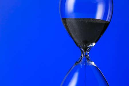 Photo pour Crystal hourglass on color background - image libre de droit