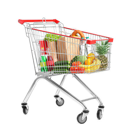 Photo pour Shopping cart with products on white background - image libre de droit