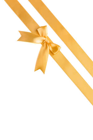 Photo pour Golden ribbons with beautiful bow on white background - image libre de droit