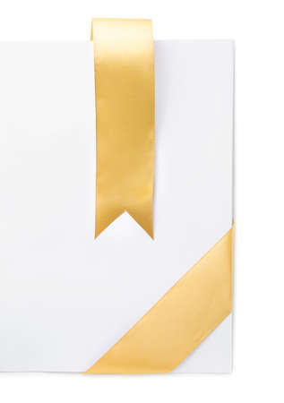 Photo pour Blank sheet of paper with golden ribbon on white background - image libre de droit