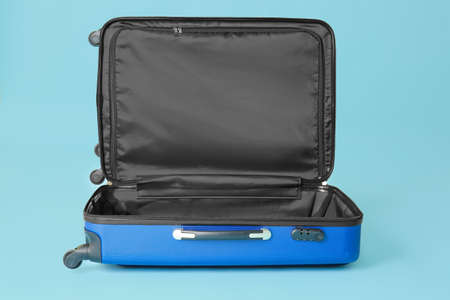 Photo for Open empty suitcase on color background - Royalty Free Image