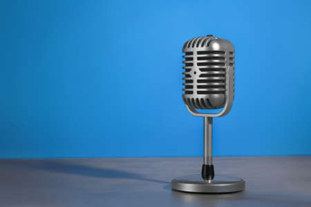 Photo for Retro microphone on color background - Royalty Free Image