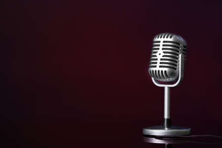 Photo for Retro microphone on dark color background - Royalty Free Image