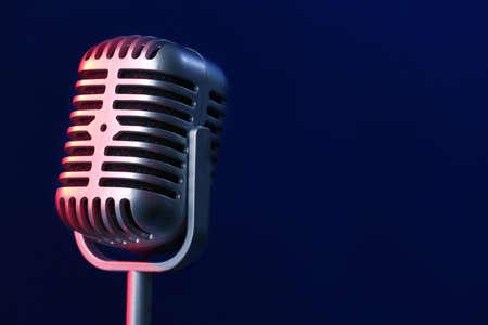 Photo pour Retro microphone on dark color background - image libre de droit