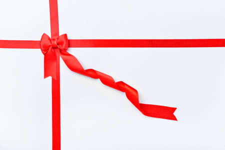 Photo pour Beautiful red ribbons and bow on white background - image libre de droit