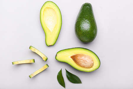 Foto de Ripe avocados on light background - Imagen libre de derechos
