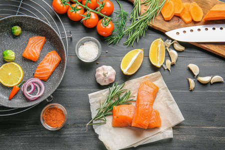 Photo for Composition with fresh raw salmon on table - Royalty Free Image