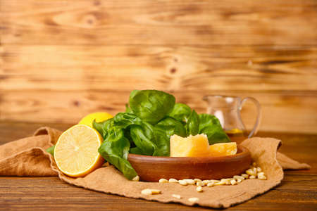 Photo for Ingredients for pesto sauce on wooden background - Royalty Free Image