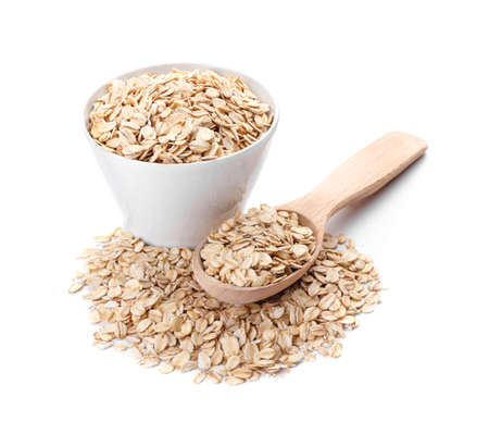 Photo for Bowl and spoon with raw oatmeal on white background - Royalty Free Image