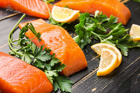 Photo for Raw salmon fillet with herbs and lemon on table - Royalty Free Image