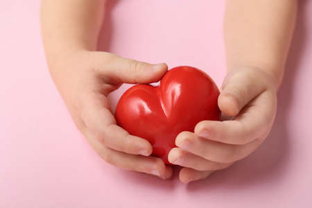 Photo for Child's hands with red heart on color background. Cardiology concept - Royalty Free Image