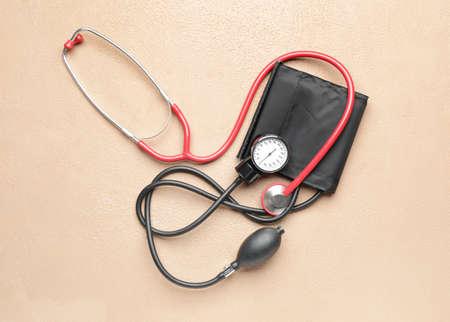 Photo pour Stethoscope with sphygmomanometer on color background - image libre de droit