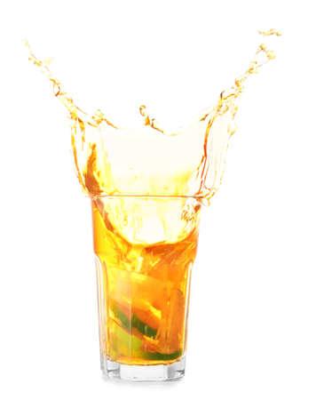 Photo pour Glass of tasty cold ice tea with splash on white background - image libre de droit