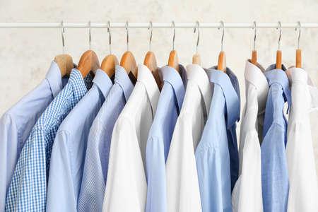 Photo pour Rack with clothes on light background - image libre de droit
