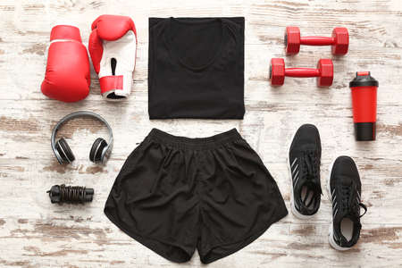 Photo pour Sportswear and equipment on wooden background - image libre de droit