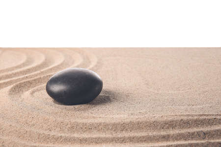 Photo for Stone on sand with lines against white background. Zen concept - Royalty Free Image