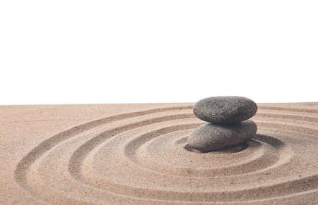 Photo pour Stones on sand with lines against white background. Zen concept - image libre de droit