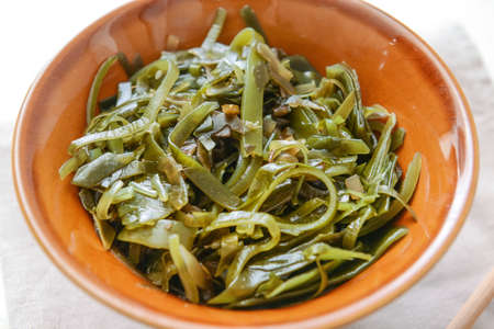 Photo for Bowl with tasty seaweed on table, closeup - Royalty Free Image