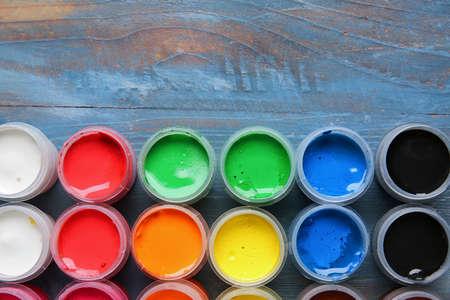 Foto de Bottles of gouache paints on table - Imagen libre de derechos