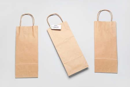 Photo pour Paper shopping bags on light background - image libre de droit
